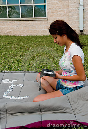 A college girl playing domino