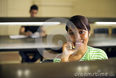 College library and female student, black woman looking at camer