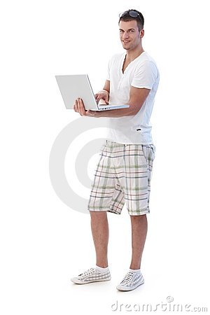 College student browsing internet smiling