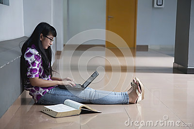 College Student In Campus Aisle Royalty Free Stock Image - Image: 25805186
