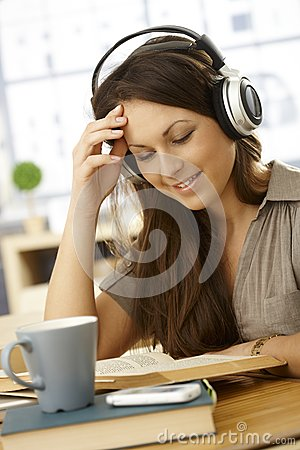 College student learning at home with headphones