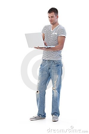 College student using laptop standing