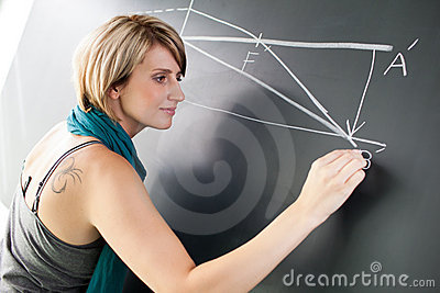 College student writing on the blackboard