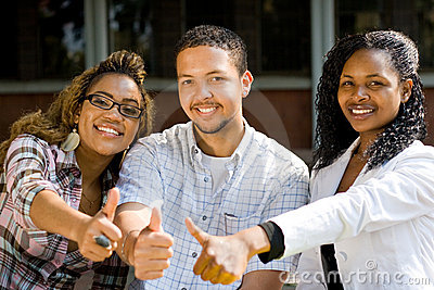 College students thumbs up