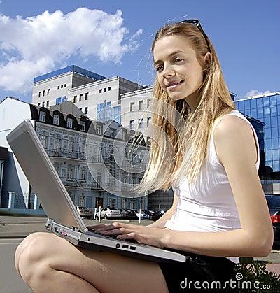 Collegian near a modern building