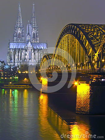 Cologne Cathedral and iron Bridge at night Stock Photo