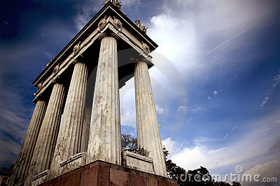 Colonnade on background of dramatic sky
