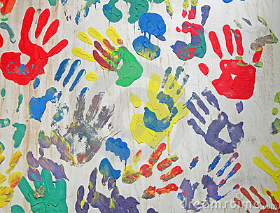 Color handprint diversity on concrete white wall