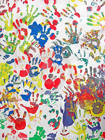 Color hands on wall, handprint heap diversity