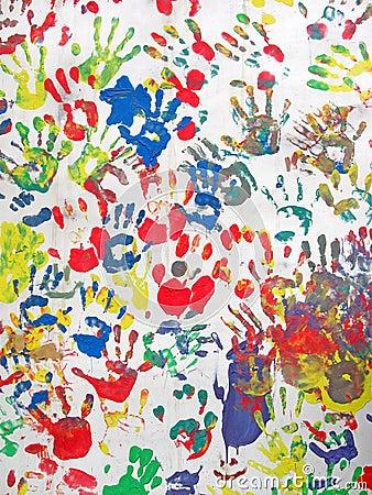 Color hands on wall, handprint heap diversity
