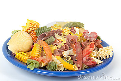 Color italien pasta on blue plate