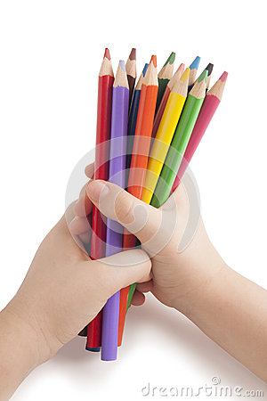 Color pencils in child hands