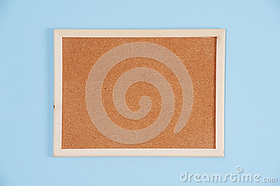 Color shot of a brown cork board in a frame