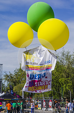 Colored balloons lifting giant T-shirt Editorial Image