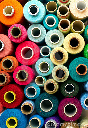 Free Colored Bobbins Royalty Free Stock Photography - 23222537