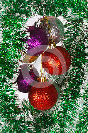 Colored Christmas balls on a green tinsel
