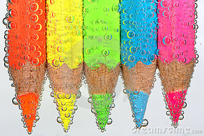 Colored crayons with bubbles