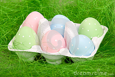 Colored easter eggs in cardboard