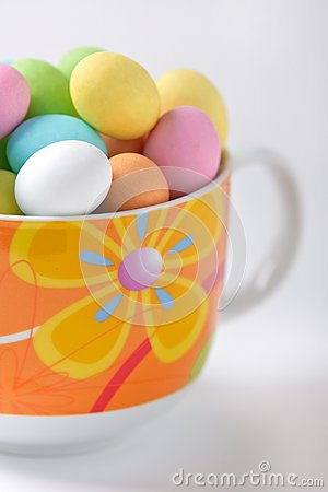 Colored easter eggs in a cup