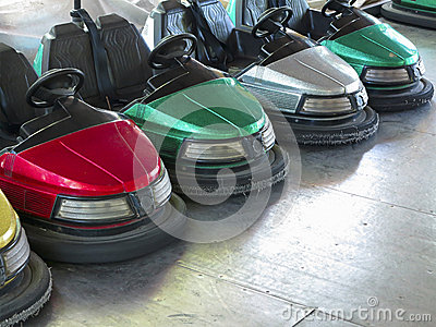 Colored electric cars in amusement park