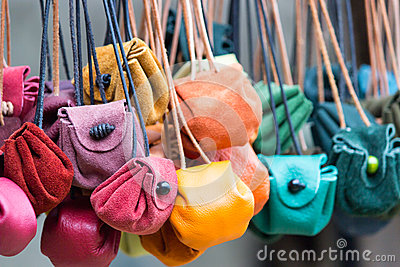 Colored leather moneybags hanging at laces