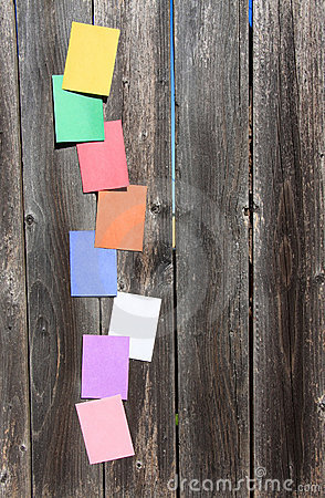 Free Colored Papers On The Wood Stock Images - 22726184