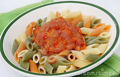 Colored pasta with tomato sauce