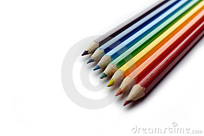 Colored pencils arranged in rainbow spectrum order