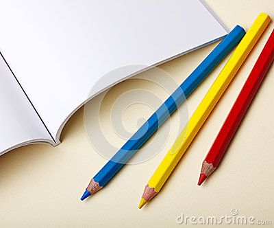 Colored Pencils and Blank Book