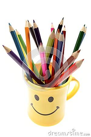 Colored pencils in mug