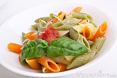Colored penne pasta with cheese