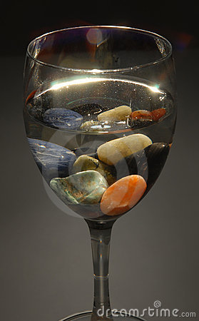Free Colored Stones In A Glass Of Water Stock Images - 11564534
