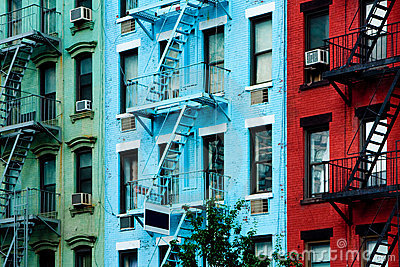 Colorful apartment buildings with fire escapes