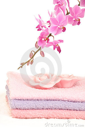 Colorful bathroom set with towels and orchid