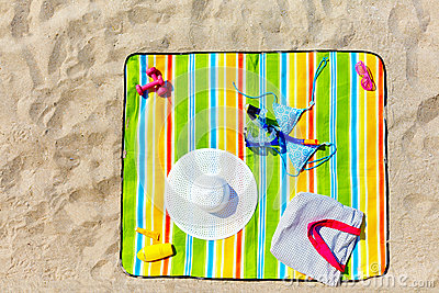 Colorful beach blanket with woman items