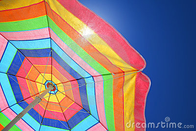 Colorful beach umbrella on a sunny day