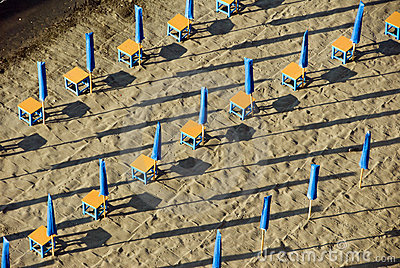 Colorful beach umbrellas in neat rows