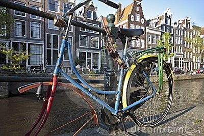 Colorful bike against a bridge Amsterdam Holland