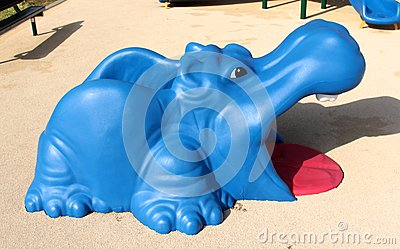 Colorful Blue and Red Hippopotamus Toy on Childrens Playground