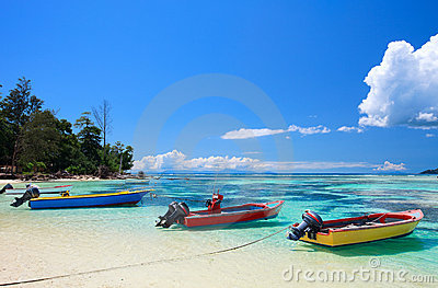 Colorful boats at sea shore