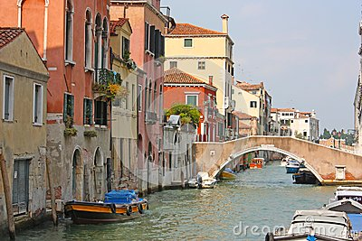 Colorful bridge across canal in Venice