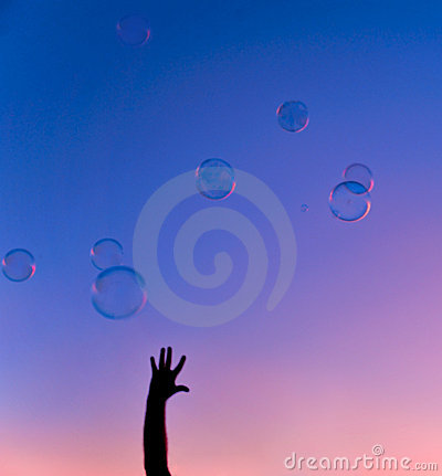Colorful bubbles with hand sunset