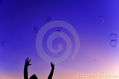 Colorful bubbles with hands sunset