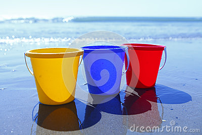 Colorful buckets on beach