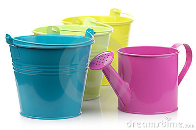 Colorful buckets and watering can