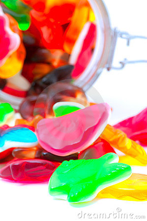 Colorful candies in a glass jar