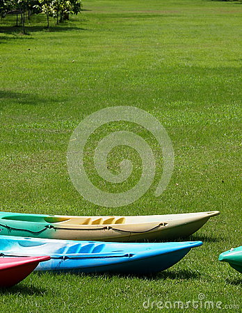 Colorful canoes on a lake bank