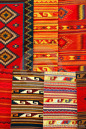 Colorful carpets hanging on the market. Mexico