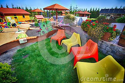 Colorful chairs in backyard