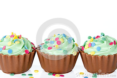 Colorful chocolate cupcakes on white
